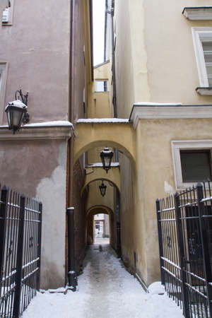 An alley - historic architecture of the old town of Warsaw, Poland