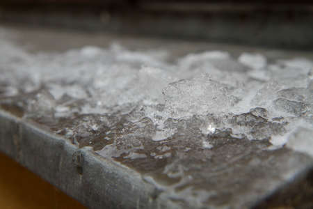 Ice on a window sill in close up
