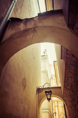 A back alley - historic architecture of the old town of Warsaw, Poland