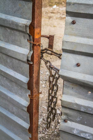 A gate closed with a chain - focus on the chain