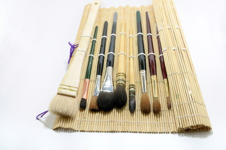 Aquarel borstels met natuurlijke bamboe borstelhouder Stockfoto