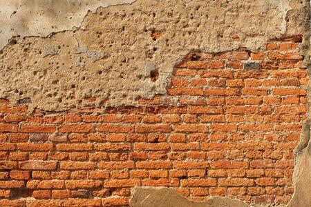 cracked concrete: Cracked concrete brick wall