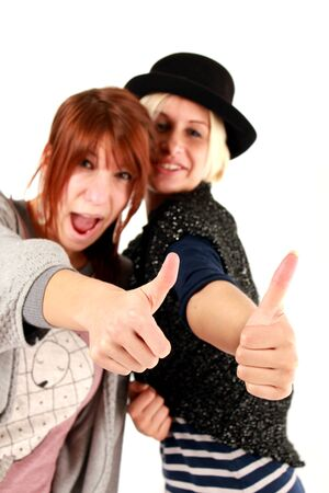 thumps up: thumps up girls Stock Photo