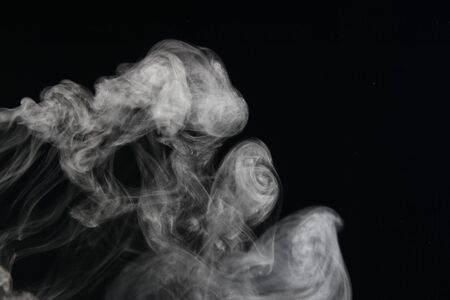 an abstract smoke picture in front of a black background photo