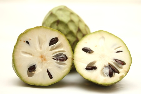 annona: isolated cherimoya fruit Stock Photo