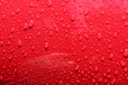 raindrops on a red surface Stock Photo