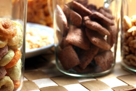 a mix of breakfast cereals photo