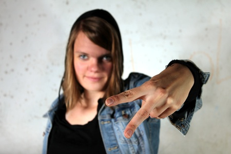 woman showing peace sign photo
