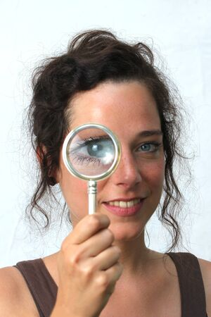 young woman with magnifier Stock Photo - 14618928