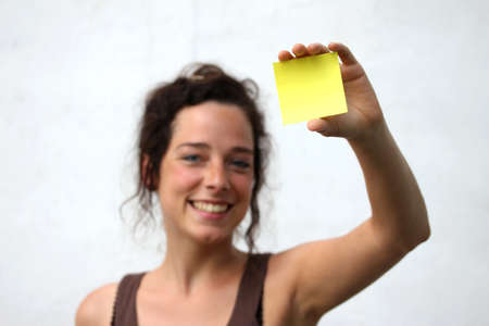 young woman with yellow note paper Stock Photo - 14618926