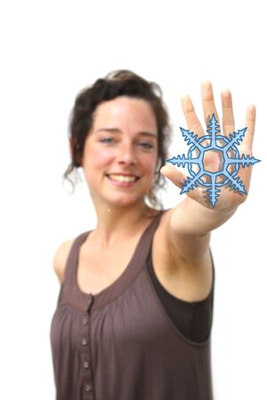 wheater: young woman pointing with her hand at a digital snowflake Stock Photo