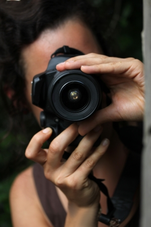 slr camera: young woman with a dslr camera Stock Photo