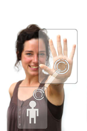 young woman pointing at a digital social interface with her left hand photo