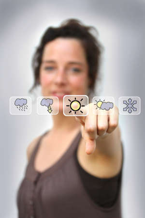 young woman pointing at a digital weather interface Stock Photo - 14649557