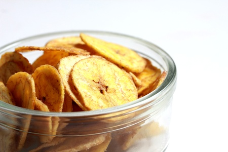 a bowl of banana chips photo