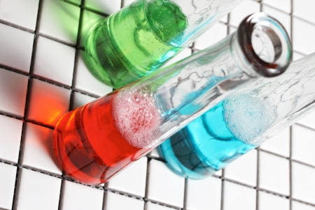some liquids in some test tubes photo