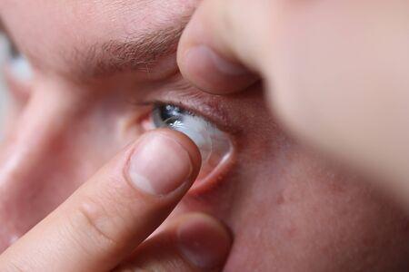 contact lense: guy bringing in a contact lense