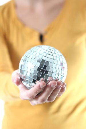 girl with mirror ball in her hand photo