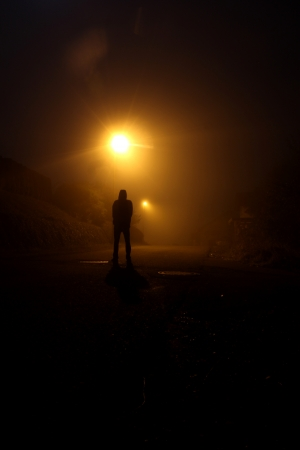 streetlights: shadow of a man in the night Stock Photo