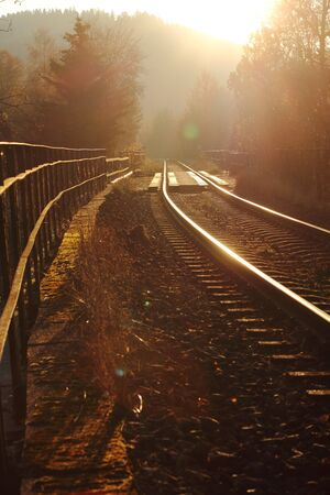 lonly railway tracks on a golden autumn day Stock Photo - 16458678