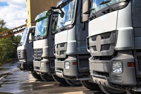 high dynamic range: plain grey trucks in a row