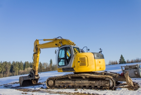 new excavator in the snow photo