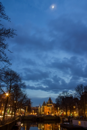 residential idyll: view on the Amsterdam De Waag at the evening