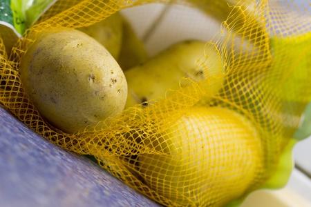 potatos: fresh potatos in a net