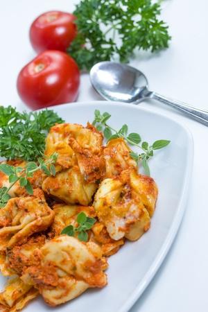 ovenbaked: oven-baked tortellini Stock Photo
