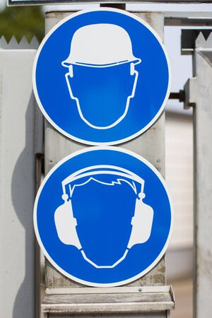 hearing protection and helmet mandatory signs