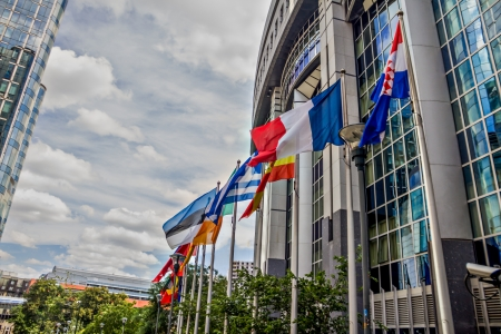office politics: EU parliament building in brussels with country flags