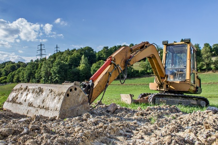 excavator in the countryside photo