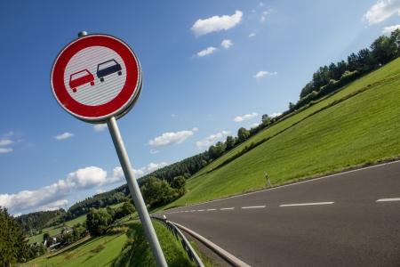 overtake: overtake prohibited sign