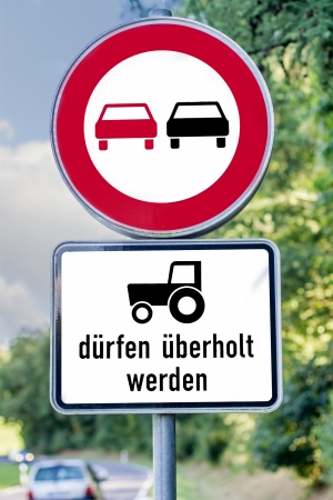 overtake: german overtake prohibited but overtake tractor allowed sign