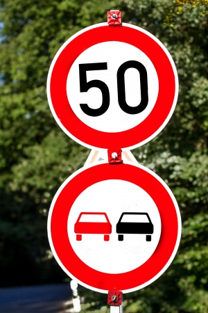 overtake: drive fifty and overtake prohibited signs Stock Photo