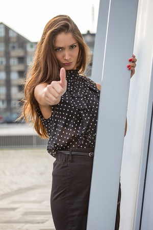 thumps up: beautiful young woman giving thumps up Stock Photo