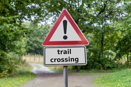 trail crossing sign in the forest photo