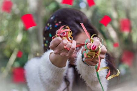 scandinavian descent: young party woman with confetti in her hands