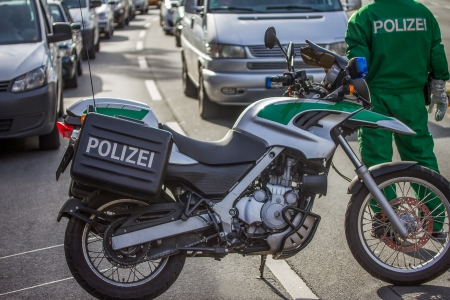a white police motorcycle: german police street barricade
