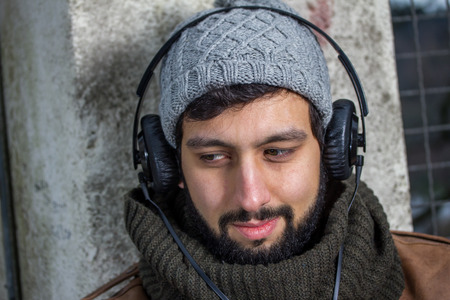 beard man hearing music photo