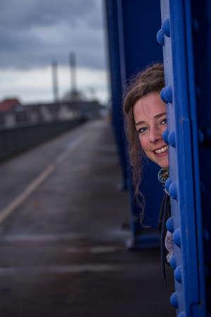 woman outdoors on a bridge photo
