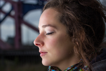 woman relaxing in light outdoors photo