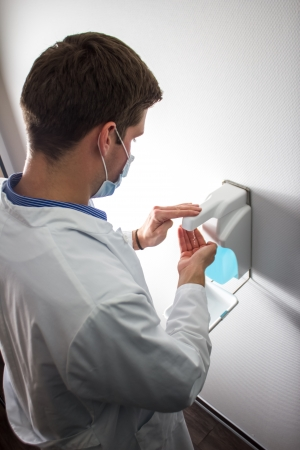 disinfecting: doctor disinfecting hands