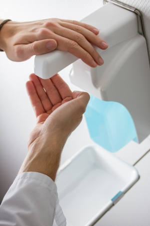 disinfect: disinfect hands Stock Photo