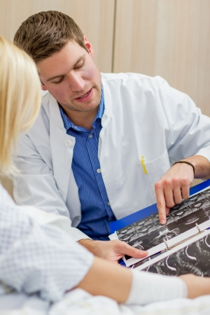 doctor talking with female patient in a hospital photo
