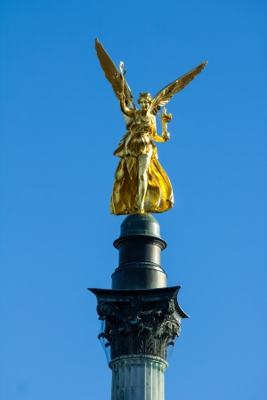 golden peace angel statue in munich photo
