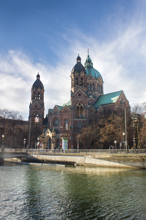 St Lukas church and the Isar river in munich photo