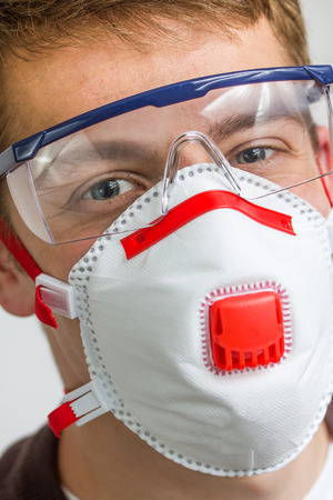 asbestos: craftsman with safety protection gear Stock Photo
