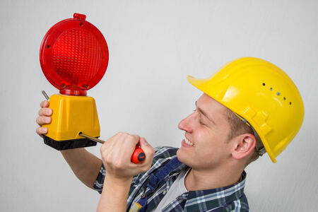 construction worker with a red construction site-lamp photo