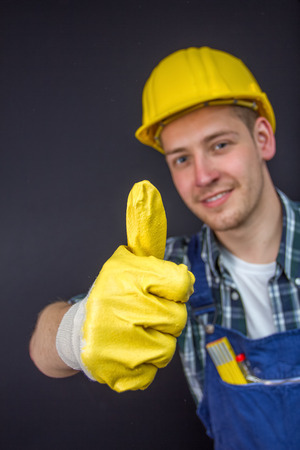 construction worker making thumbs up sign photo